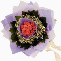 12 adet gül ve elyaflardan   Bartın çiçekçi mağazası
